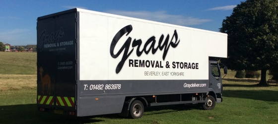 picture of three graydeliver removal vans